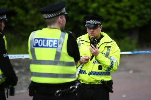 """Three men with weapons attack woman (69) in """"cowardly"""" raid at north Glasgow home"""