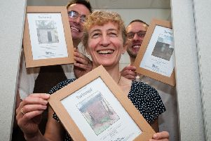 Residents of Buckshaw Village show off their twinned toilet certificates, and soon someone in Uddingston will be able to do likewise