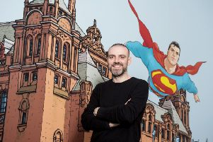 Frank Quitely with his image of Superman flying over Kelvingrove. Pic: SNS.