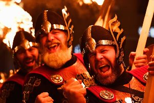 Vikings take part 'during a torchlight procession through Edinburgh. (Photo by Jeff J Mitchell/Getty Images)
