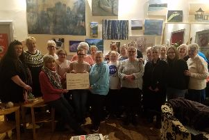 Motherwell Crafty Knit-Wits present the cheque for �1900 to South Dalziel Historic Building managing director Moira Harvey