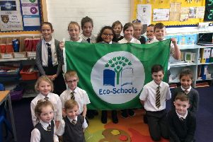 Pupils at Mossend Primary show off their new Green Flag