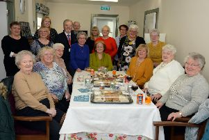 Staff and residents of Woodlands Grove in Viewpark are joined by Councillor Bob Burrows and Provost Jean Jones, who officially opened the new common room