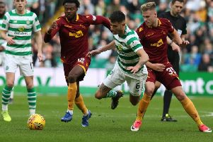 Motherwell's Gboly Ariyibi (left) scored Motherwell's controversial opener at Celtic Park after the initial shot by James Scott (right) had been saved (Pic by Ian McFadyen)