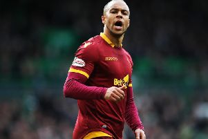 Motherwells Charles Dunne shows his determination against Celtic on Sunday (Pic by Getty Images)