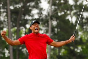 Tiger Woods roar after winning his fifth Masters title (Kevin C. Cox/Getty)