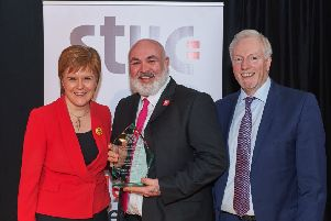 Chris McGill, recipient of the STUC Helen Dowie Award for Lifelong Learning 2019, with First Minister Nicola Sturgeon and Grahame Smith, STUC general secretary