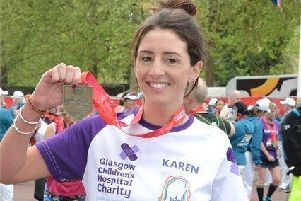 Karen Barnstaple shows off her medal after completing the London marathon