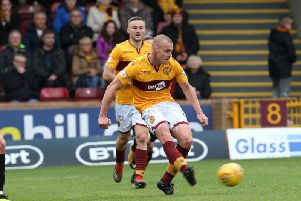 Grimmy in action against Livingston (Pic by Ian McFadyen)