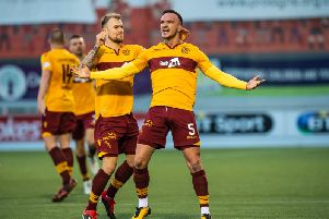 Tom Aldred celebrates with Richard Tait after scoring one of his two goals in a 2-1 league win at Hamilton Accies on December 29 last year (Pic by Ian McFadyen)