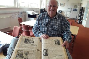 Leslie Dalziel reads about his previous visit to Motherwell in the Times & Speaker archives which are held at North Lanarkshire Heritage Centre
