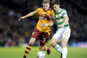Kieran Tierney battles for possession with old schoolmate Chris Cadden during the 2017 Betfred Cup final (pic: Michael Gillen)
