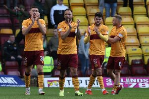 Gallagher (1st left) applauds fans after Hibs win with mates Hartley, Donnelly and Campbell (Pic by Ian McFadyen)