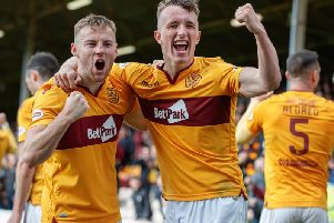 David Turnbull (right) celebrates a Motherwell goal last season with Allan Campbell