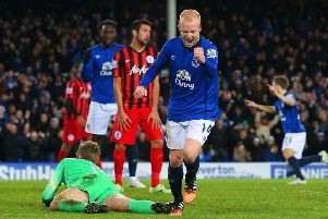 Steven Naismith celebrates after putting Everton 3-0 ahead in the second half last night.  Picture: Getty