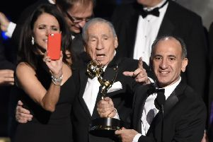 Veep star Julia Louis-Dreyfus snaps creator Armando Iannucci receiving the gong for comedy from Mel Brooks. Picture: AP