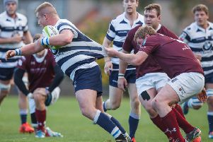 Murray McCallum of Heriot's is grabbed by Ewan Dodds. Picture: Toby Williams