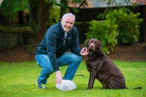 John Rutherford in his garden in Selkirk with his dog Leo. Picture: Ian Georgeson