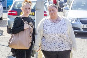 Rachael Fee, or Trelfa, left, and her partner Nyomi Fee outside the High Court in Livingston. Picture: PA