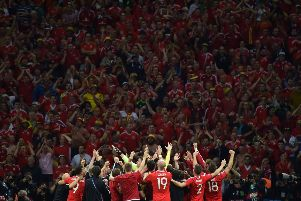 Wales celebrate in front of their ecstatic fans. Picture: Getty Images
