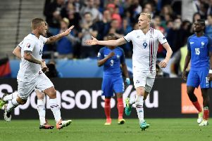 Antoine Griezmann chips over Iceland goalkeeper Hannes Halldorsson to score France's fourth goal in the Stade de France. Picture: AFP/Getty Images