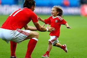 The joy on the face of Gareth Bale's daughter Alba Violet as she runs to her dad after Friday's victory reflects the mood of a nation. Picture: Getty Images
