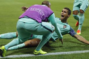 Ronaldo is jubilant after heading Portugal ahead in the 50th minute last night. Picture: Frank Augstein/AP