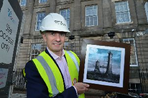 Hotel manager Douglas Winfield holds up an example of some of the artwork to be displayed in the new hotel. Picture; Jon Savage