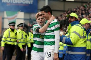Celtic's Tom Rogic (right) celebrates scoring the winning goal with team-mate James Forrest. Picture: Jane Barlow/PA Wire