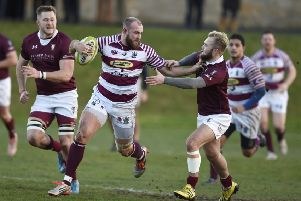 Watsonians' Rory Drummond hands off Gala scrum-half Connor Adams at Myreside.  Picture: Ian Rutherford
