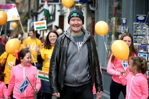 Scottish novelist Irvine Welsh takes part in a charity walk down Edinburgh's Royal Mile. Picture: Jane Barlow/PA Wire