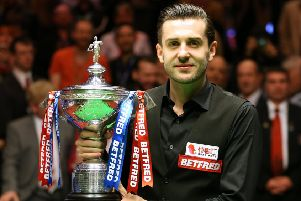 Mark Selby celebrates winning the Betfred Snooker World Championship. Picture: PA