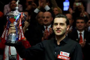 Mark Selby with the World Cham[ionship trophy after his 18-15 win over Scotland's John Higgins in the final. Picture: Warren Little/Getty Images