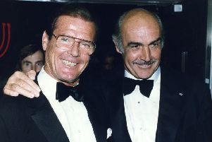 Roger Moore, left, with friend and fellow Bond Sean Connery. Picture: Contributed
