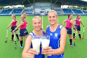 Team captains Kareena Cuthbert, left, and Becky Merchant raise a glass to the Graham's sponsorship deal. Picture: Julie Howden