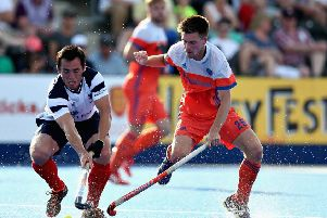 Wei Adams of Scotland battles for the ball with Thierry Brinkman of the Netherlands.  Photograph: Alex Morton/Getty Images