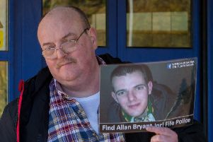 Allan Bryant senior with a picture of his son, Allan junior, who was last seen outside a Glenrothes nightclub in 2013. Picture: Steven Brown