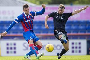 Inverness CT's Matty Elsdon battles for the ball against Falkirk's Rory Loy. Picture: SNS/Bill Murray