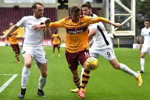 Motherwell's Elliott Frear takes on Berwick's Darren Laverty (left). Picture: SNS/Rob Casey
