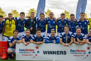 The Scotland squad are all smiles as they pose with their winners' medals following yesterday's European Nations Championship II final victory over Wales at Glasgow Green. Photograph: Duncan Gray