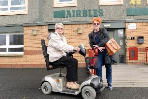 Margaret Grier (L) and Vicky Turner outside Airbles Tower. Neighbours had to carry Margaret's mobility scooter down the stairs so she could get out. Picture: SWNS