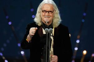 "Legendary entertainer Sir Billy Connolly is to be inducted into a Scottish music ""hall of fame"" in his home city next month."