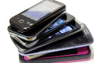 Citizens Advice found three of the four major mobile phone providers are charging customers too much for old handsets. Picture Michael Gillen.