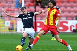 Dundee's Paul McGowan (left) and Adam Barton in action. Picture: SNS/Craig Foy