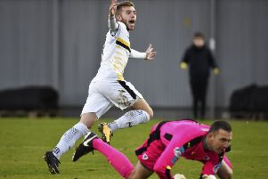 Dumbarton's Alistair Roy celebrates after scoring to make it 2-0. Picture: SNS/Rob Casey