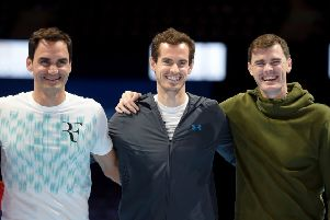 Sir Andy Murray flanked by his brother Jamie, right, and Roger Federer. Picture: John Devlin