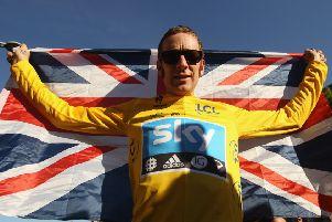 Sir Bradley Wiggins celebrates his Tour deFrance victory. Picture: Bryn Lennon/Getty Images