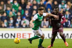 Darren McGregor challenges Esmael Goncalves for the ball during the last Scottish Cup meeting between Hibs and Hearts. Picture: Ian Georgeson
