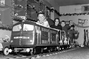 Children play on the model of the Golden Arrow engine in Jenners, Edinburgh, November 1965
