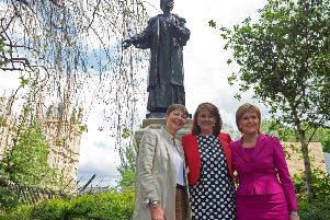 Nicola Sturgeon with Plaid Cymru leader Leanne Wood (centre), and Green Party co-leader Caroline Lucas (left) near a statue of the leading suffragette Emmeline Pankhurst (Picture: AFP/Getty Images)